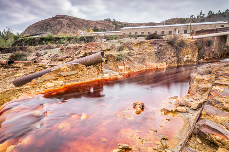 The Rio Tinto Red River is a river in southwestern Spain. As a possible result of the mining, Ro Tinto is remarkable for Being very acidic pH 2 and Its deep reddish hue is due to iron dissolved in the water. Stock Photo