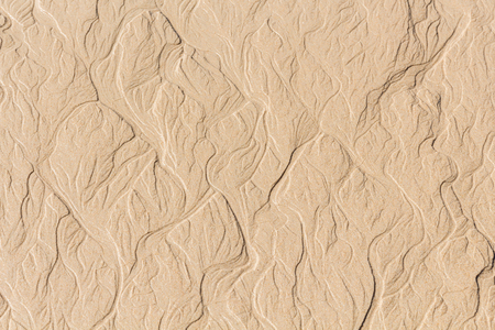 meanders: Beach erosion pattern sand. Water FORMED meanders on beach.