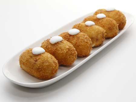 Six spanish croquettes With mayonnaise. Typical cover of Spanish Cuisine on white background