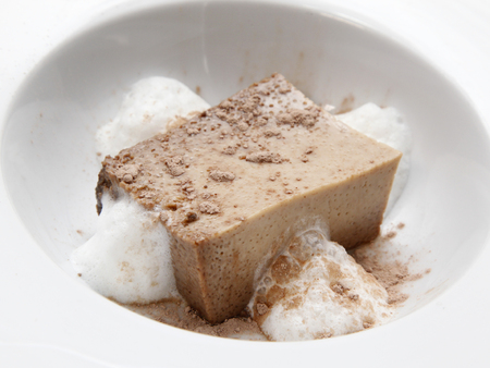 'yule tide': An individually plum pudding topped with cocoa powder and surrounded by cream foam