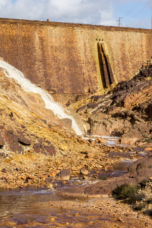 kwaśne deszcze: Waterfall in Riotinto mining area, Andalusia, Spain. The Rio Tinto Red River is a river in southwestern Spain.