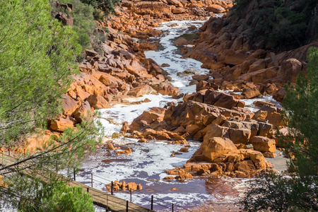 acidic: River bed Tinto, Huelva, Andalusia, Spain. As a possible result of the mining, Rio Tinto is remarkable for Being very acidic and Its deep reddish hue is due to iron and copper. Stock Photo