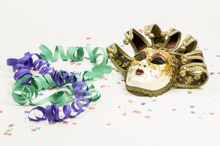 white mask: Carnival Venetian mask with confetti and streamers on white background Stock Photo