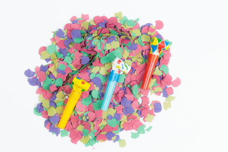 blower: confetti and party blower on white background