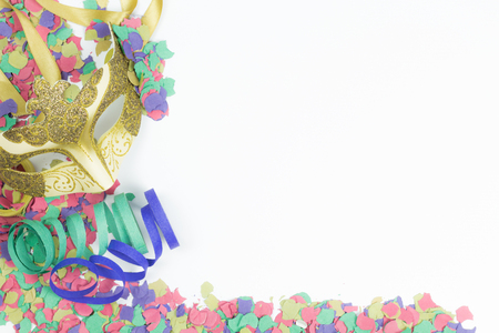 venician: Carnival Venetian mask with confetti and streamers on white background Stock Photo