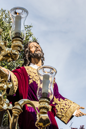 devote: Holy Week in San Fernando, Cadiz, Spain. Prayer of Our Lord in the Garden. This Brotherhood goes in procession on Tuesday of Holy Week during the celebration of this important religious. Holy Week is the commemoration of Jesus last week of the life, his c