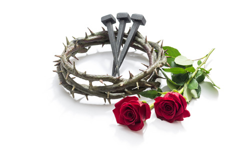 Jesus Christ crown of thorns, nails and two roses on a white background. 스톡 콘텐츠