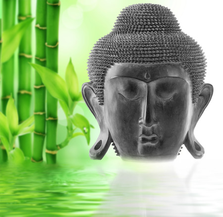 deportes: Front view of Buddhas face on bamboo background Stock Photo