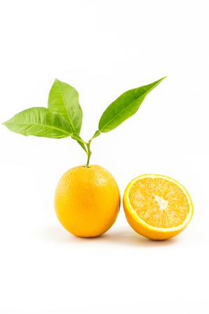 two objects: Fresh orange isolated with leafs and Orange Slice on white background. Two Objects. Orange Slice. Stock Photo