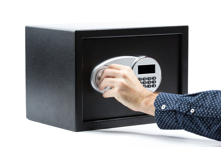 futility: Man hand opened a safe deposit box on a white background