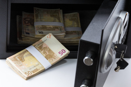stainless steal: Safe Deposit Box, Pile of Cash Money, Euros. Closeup, On white background