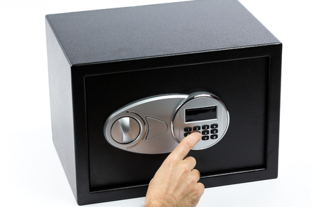 futility: Mans hand opening electronic door of a safe deposit box on white background