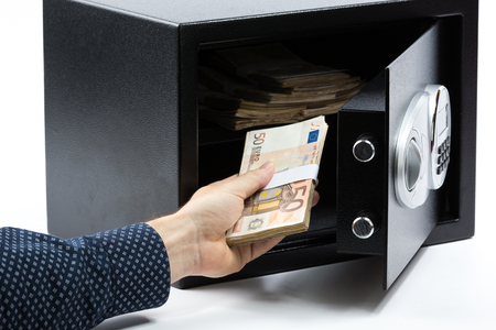futility: Male hand keeping euro banknotes in a safe deposit box on white background Stock Photo