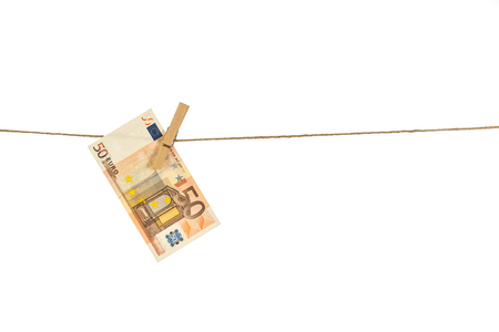 50 Euro banknote hanging on clothesline on white background. Money laundering concept