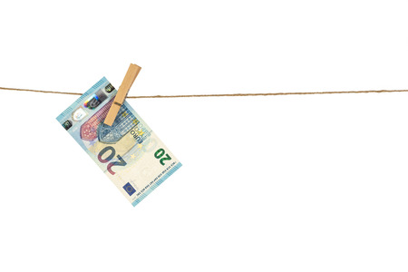 20 Euro banknote hanging on clothesline on white background. Money laundering concept