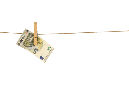 5 Euro banknote hanging on clothesline on white background. Money laundering concept