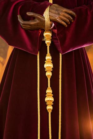 sacred trinity: Holy week in Cadiz, Spain. christ of medinaceli. Hands and robe details.