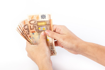Close up of female hand holding 50 euro banknotes isolated on white background 版權商用圖片