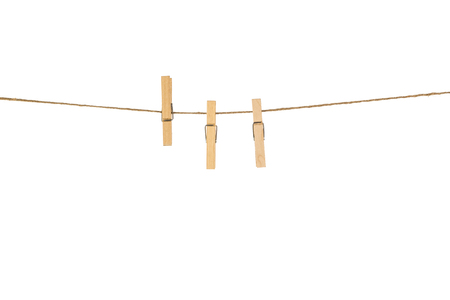 With the wooden clothespins on a white background rope