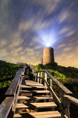 Camarinal Lighthouse and stairs at night in Cadiz coast, andalusia, Spain. Nightscene, lightpanting
