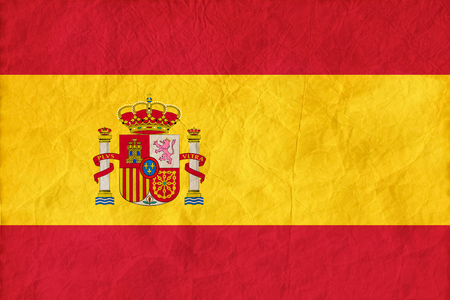 Spain Flag on paper texture background. National Concept Imagens