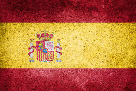 Spain Flag on wall texture background. National Concept