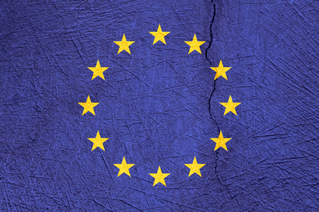European Union flag on cracked texture background. Symbol, Politic Concept.