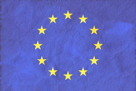 European Union flag on paper texture background. Symbol, Politic Concept.