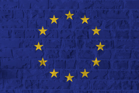 European Union flag on brick wall texture background. Symbol, Politic Concept.