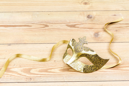 Carnival Venetian mask isolated on wood background Imagens