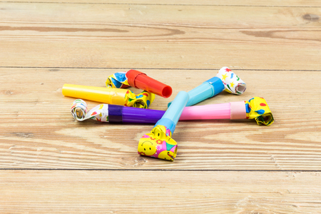party blowers on wood background Imagens