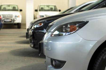 dealerships: Row of cars for sale in motor dealership