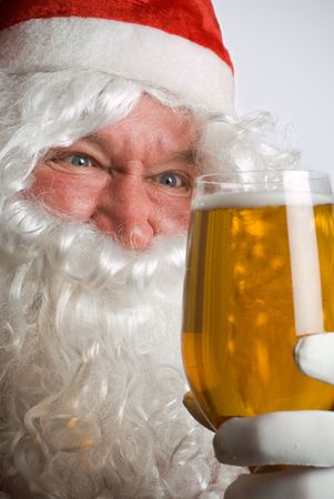 Father Christmas Santa looks at a lovely glass of beer photo