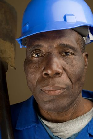 African American Construction Worker Resting Shovel on His Shoulder photo