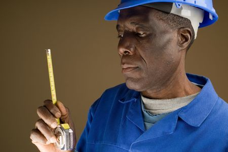 African American Construction Worker Holding a Tape Measure Stock Photo - 4947729