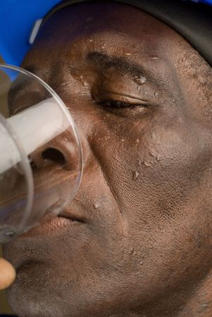 Tired Construction Worker Drinking Water  photo