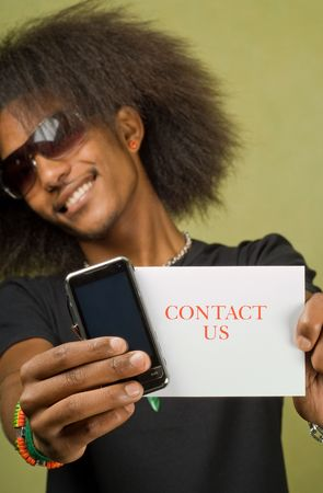 Young Trendy African American Male Holding Card with Cellphone, Contact Us photo