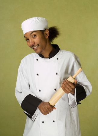 Young Handsome African American Chef Holding Rolling Pin in Hands photo