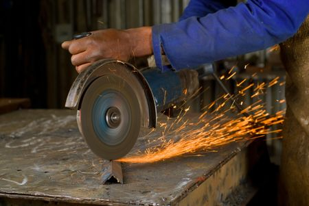 South or African American working with angle grinder photo