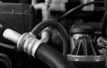 doityourself: Car engine hose and parts diy maintenance concept theme in black and white