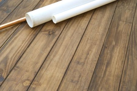 plasticity: Plumbers plumbing pipes on wooden work table - space for text
