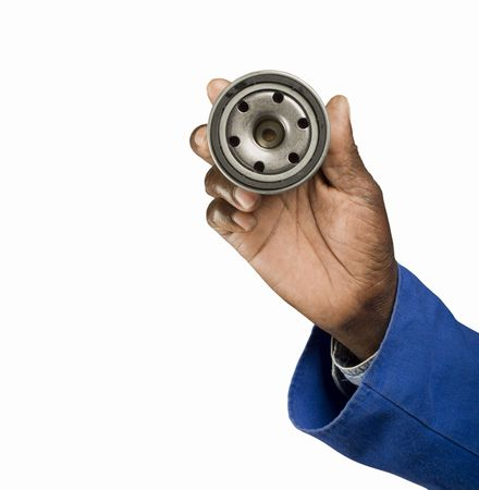 South African or American blue collar mechanic hand with oil filter service car maintenance Stock Photo
