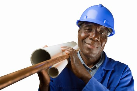 Senior South African or American plumber with pipes Stock Photo