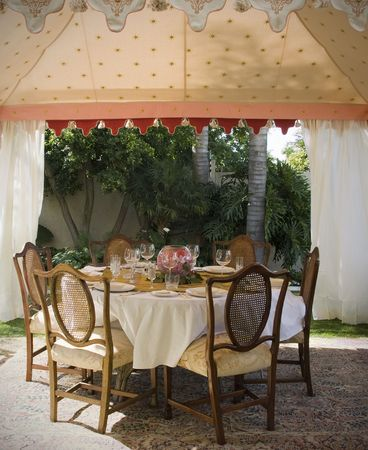banquette: Party lunch, wedding or dinner tent in suburb garden with table and chairs