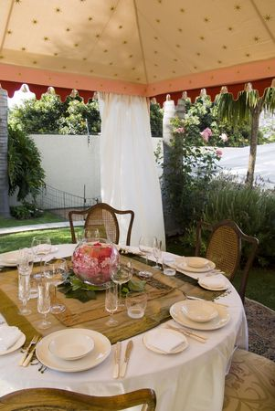 Party lunch, wedding or dinner tent in suburb garden with table and chairs photo