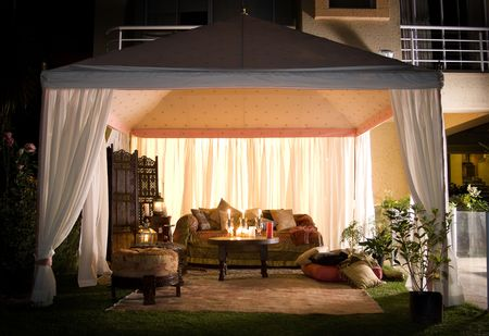 awning: Garden party or wedding entertainment tent in garden at night Stock Photo
