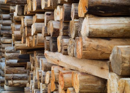 pile of logs: Stacked wood or timber in factory warehouse or storage area