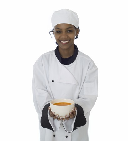 Professional chef in workwear jacket serving soup isoltated on white photo