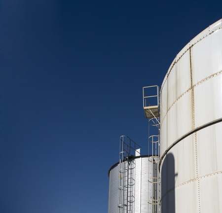 Industrial storage gas tank on blue sky