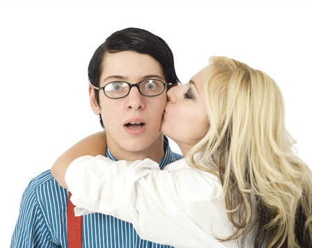 geek: Nerd business man surprised by kiss from pretty valentine girl isolated on white